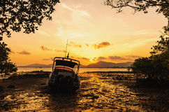 Boat on the beach with color of sunset Royalty Free Stock Images