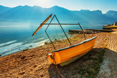 Boat on the beach early in the morning Stock Photos
