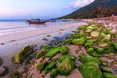 Boat, beach, evening, stones Stock Photos