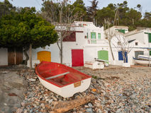 Boat at the beach, fishermen`s buildings stock image