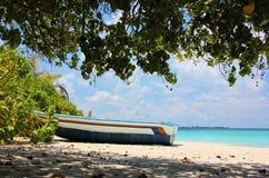 Boat on the beach, Lonubo Island, Maldives. Colorful boat on a white sand beach in the Maldives. Twin island of Lonubo. Ari Atoll Royalty Free Stock Image