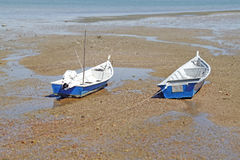 Boat on beach at low tide. Two boat stranded on the beach during low tide royalty free stock photos