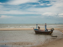 Boat on the beach when low tide Royalty Free Stock Photo