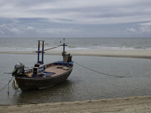 Boat on the beach when low tide Stock Photos
