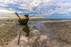 The boat on the beach royalty free stock photography