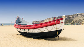 Boat on the beach in Nazare in Portugal Royalty Free Stock Images