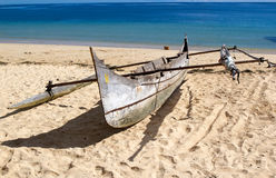 Boat on the beach, Nosy Be, Madagascar. Traditional fisherman boat on the beach, Nosy Be, Madagascar. Nosy Be is an island off the northwest coast of Madagascar Stock Images
