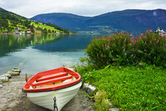 Boat on the beach of Olden. Stock Photo