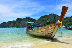 Boat on the Beach, Phuket. Long Tail Boat on the Beach of Ko (Island) Phi Phi, Phuket, Thailand Royalty Free Stock Photos