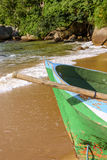 Boat on the beach. Rowing fishing boat in wood on the sand of the Red Beach on the Big Island in Angra dos Reis Royalty Free Stock Photo