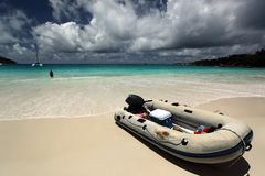 Boat on beach. Seychelles. Stock Photos