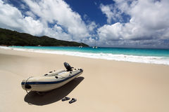 Boat on beach. Seychelles. Royalty Free Stock Image