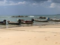 Boat beach sky sunny crown rock sand ocean royalty free stock photography