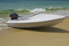 The boat on the beach Stock Photos