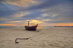 Boat on the beach at sunrise time, Baltic Sea, Debki, Poland Stock Images