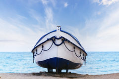 Boat on the beach at sunrise time Royalty Free Stock Photo