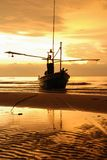 Boat on the beach at sunrise time. Seaboat on the beach at sunrise time stock photo