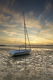 Boat on beach at sunset Royalty Free Stock Photo