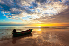 Boat on the beach at sunset Royalty Free Stock Image