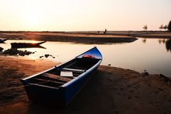 Boat on The Beach at sunset Stock Photography