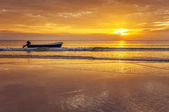 Boat on the beach at sunset Royalty Free Stock Images