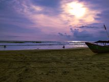 Boat on the beach with sunset royalty free stock images