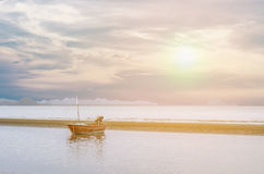 Boat on the beach with sunset at Huahin Royalty Free Stock Image