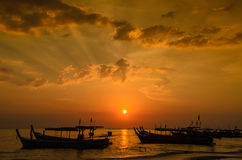 Boat at beach and sunset Royalty Free Stock Images