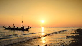 Boat at the beach and sunset. Thailand stock footage