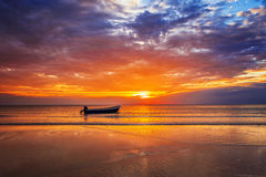 Boat on the beach at sunset Royalty Free Stock Photography