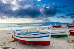 Boat on the beach at sunset time Stock Images