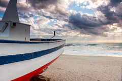 Boat on the beach at sunset time Stock Photo