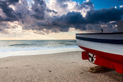 Boat on the beach at sunset time Royalty Free Stock Photography