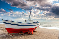 Boat on the beach at sunset time Royalty Free Stock Images