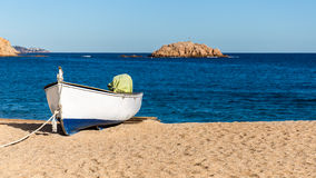 Boat on a beach, Tossa de Mar, Costa Brava, Cataloni Stock Images