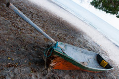 Boat, beach and tree Royalty Free Stock Images