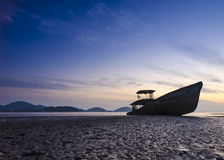 Boat on the beach in twilight time. Old boat on the beach in twilight time Stock Image