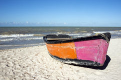 Boat on the beach under a clear blue sky Stock Photography