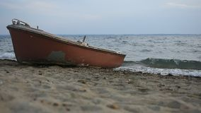 Boat on the Beach With Waves in the Background. Boat on the Beach With Waves and Sky in the Background stock video footage