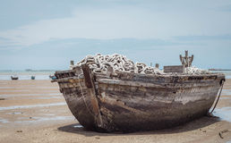 Boat. Beached derelict boat at Pattaya beach, Thailand Stock Images