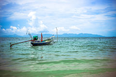 Boat on beautiful azure sea water of Koh Samui. Royalty Free Stock Photo