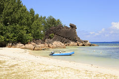 Boat at the beautiful beach of Curieuse Island in Stock Image