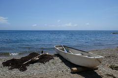 Boat in the beautiful beach stock photography