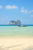 Boat in beautiful sea and tropical island with crystal clear wat Stock Photography