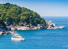 Boat on beautiful sea and tropical island Stock Image