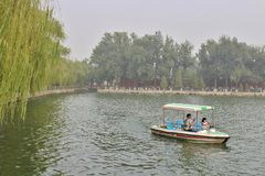 Boat in Beihai Park in Beijing. Beihai is a large park in central Beijing, People's Republic of China's capital. Beihai originally formed part of the Forbidden stock photo