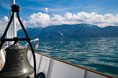 Boat bell and French Alps. View from a boat travelling on Geneva Lake towards French Alps in the distance Royalty Free Stock Photos