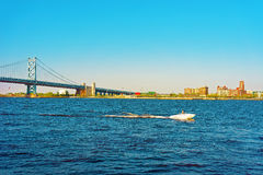 Boat at Benjamin Franklin Bridge over Delaware River in Philadelphia Stock Photos