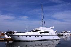 Boat at a berth. Over blue sky Stock Images