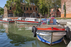 Boat with beverage on Burano island, near Venice, Italy. Royalty Free Stock Photography